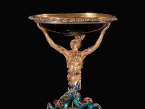 Cup with a gold mermaid